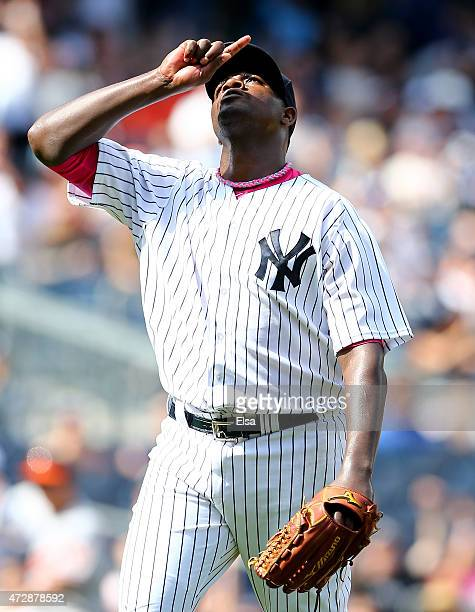Michael Pineda of the New York Yankees celebrates after he struck out his 16th batter of the game to end the seventh inning against the Baltimore...