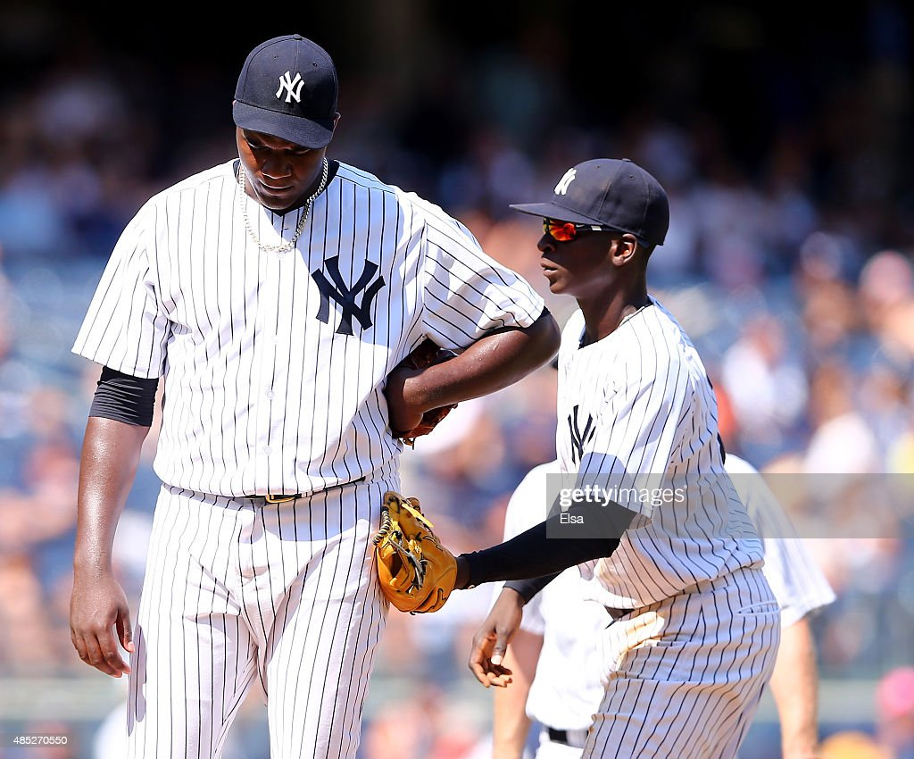Michael Pineda #35 of the New York Yankees is consoled by teammate Didi Gregorius #18 as Pineda is pulled in the fifth inning against the Houston Astros on August 26, 2015 at Yankee Stadium in the Bronx borough of New York City.
