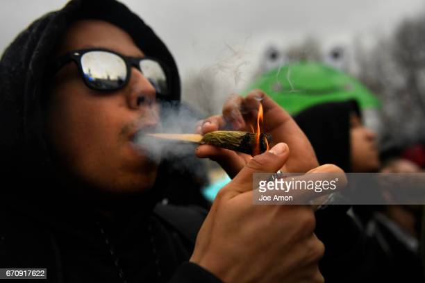 Michael Pinon of Houston Texas still working on a huge joint after the countdown at the Denver 420 Rally at Civic Center Park in downtown DenverApril...
