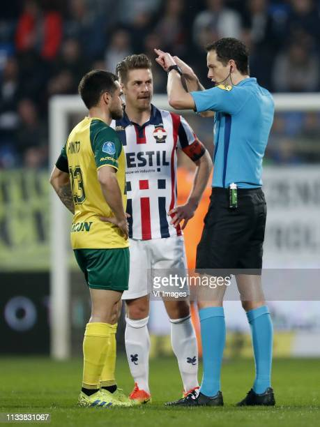Michael Pinto of Fortuna Sittard Jordens Peters of Willem II referee Richard Martens during the Dutch Eredivisie match between Willem II Tilburg and...