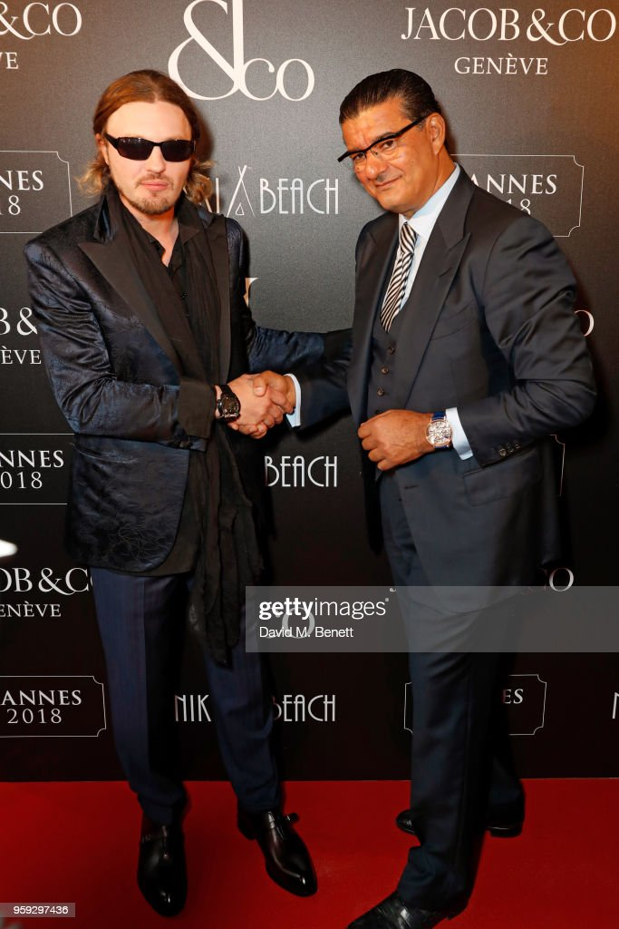 Michael Pitt (L) and Jacob Arabo attend the Jacob & Co Cannes 2018 party at Nikki Beach on May 16, 2018 in Cannes, France.