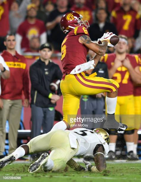 Michael Pittman Jr #6 of the USC Trojans catches a pass over linebacker Davion Taylor of the Colorado Buffaloes and runs it in for a touchdown in the...