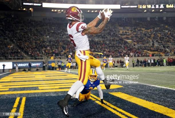 Michael Pittman Jr. #6 of the USC Trojans catches a touchdown pass over Elijah Hicks of the California Golden Bears during the second quarter of an...