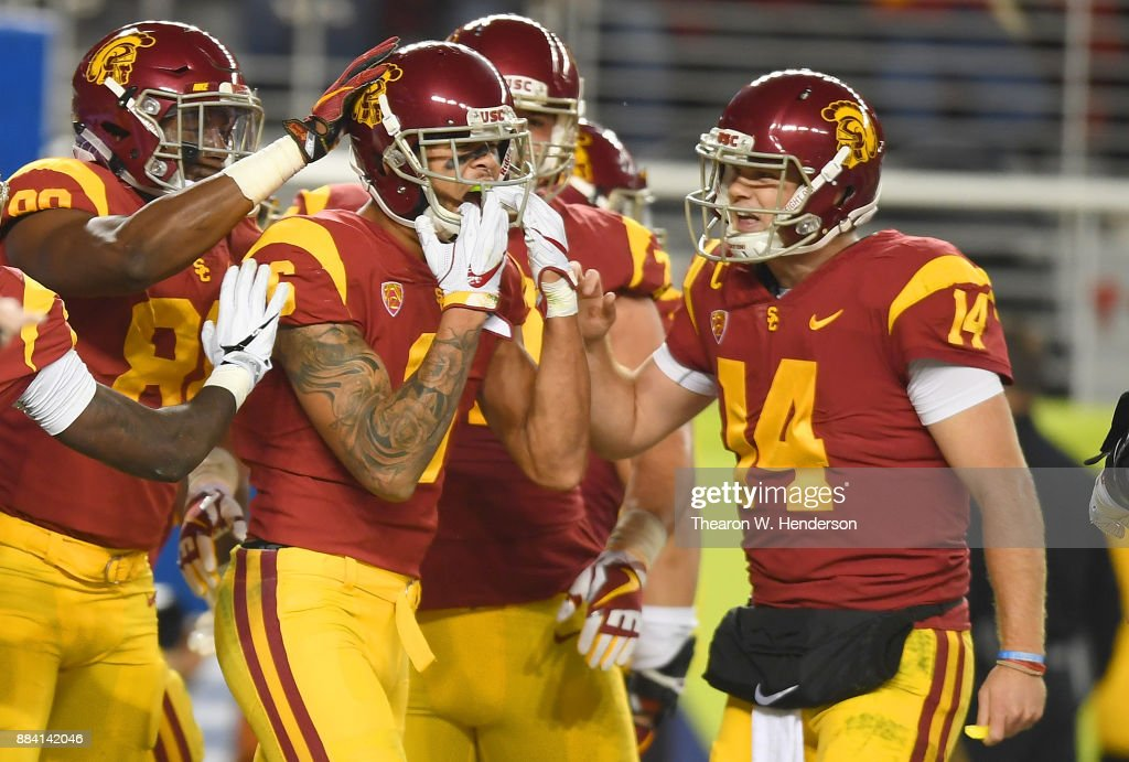 Michael Pittman Jr. #6 of the USC Trojans is congratulated by Sam Darnold #14 and Deontay Burnett #80 after Pittman caught a touchdown pass against the Stanford Cardinal during the Pac-12 Football Championship Game at Levi's Stadium on December 1, 2017 in Santa Clara, California.