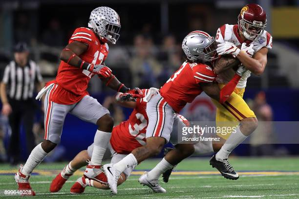 Michael Pittman Jr #6 of the USC Trojans runs the ball against Damon Arnette of the Ohio State Buckeyesduring the Goodyear Cotton Bowl at ATT Stadium...