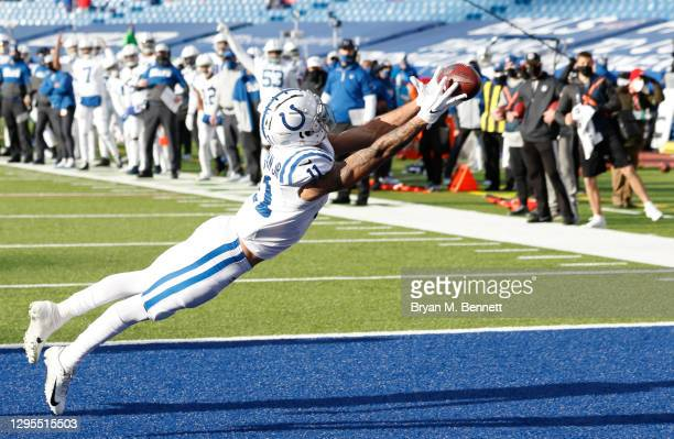 Michael Pittman of the Indianapolis Colts can't complete a touchdown pass during the first half of the AFC Wild Card playoff game against the Buffalo...