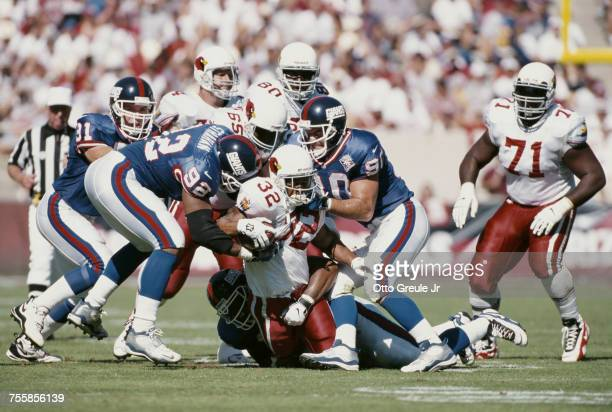 Michael Pittman Running back for the Arizona Cardinals is tackled carrying the ball by Michael Pittman and Corey Widmer of the New York Giants during...
