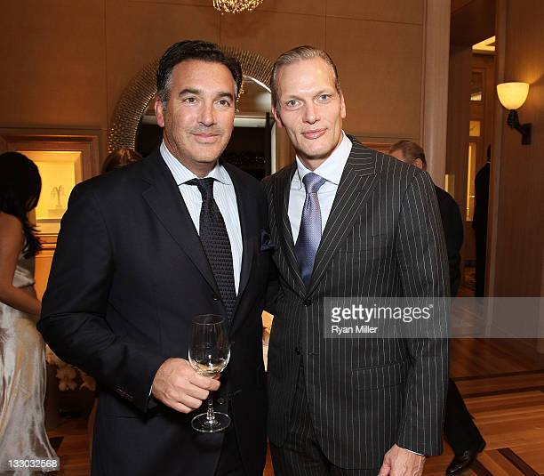 Michael Polenski Owner Blackbird Winery and Marc Hruschka President and CEO of Chopard pose during the Chopard reopening celebration of their South...