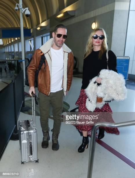 Michael Polish and Kate Bosworth are seen at LAX on December 04 2017 in Los Angeles California