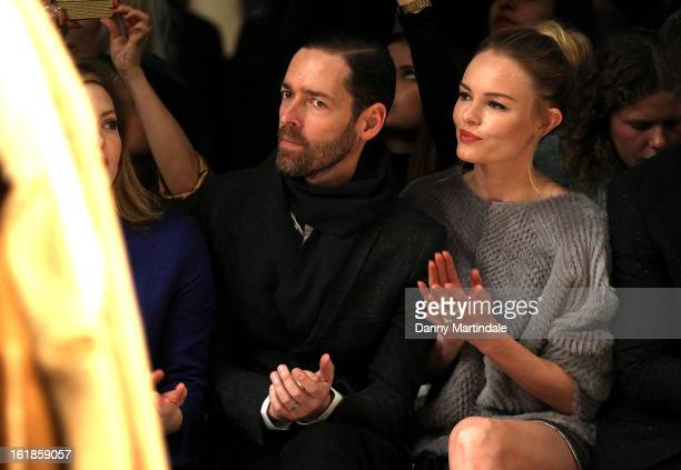 Michael Polish and Kate Bosworth attend the Unique show during London Fashion Week Fall/Winter 2013/14 at TopShop Show Space on February 17 2013 in...