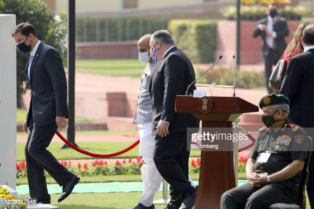 Michael Pompeo, U.S. Secretary of State, center, speaks to Rajnath Singh, India's defense minister, as they arrive with Mark Esper, U.S. Secretary of...