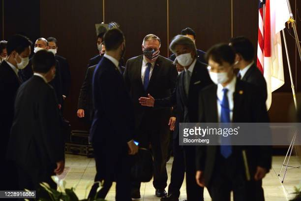 Michael Pompeo, U.S. Secretary of State, middle, arrives for a meeting with Toshimitsu Motegi, Japan's foreign minister, fourth from right, prior to...