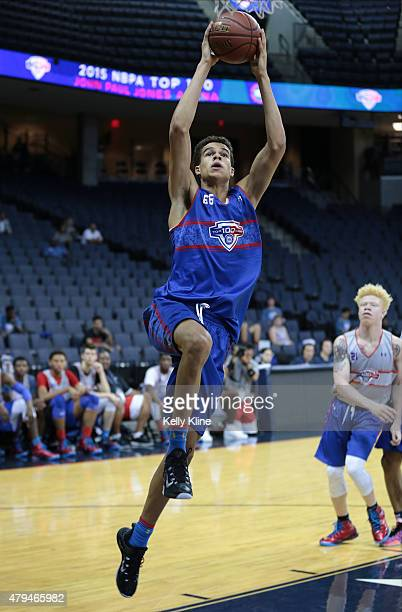 Michael Porter in blue goes for a layup during the NBPA Top 100 Camp on June 18 2015 at John Paul Jones Arena in Charlottesville Virginia