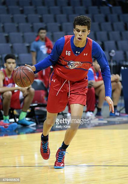 Michael Porter in red drives to the basket during the NBPA Top 100 Camp on June 19 2015 at John Paul Jones Arena in Charlottesville Virginia