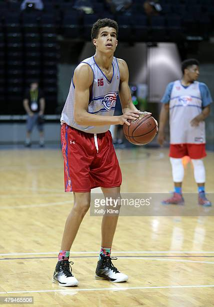 Michael Porter in white shoots a free throw during the NBPA Top 100 Camp on June 18 2015 at John Paul Jones Arena in Charlottesville Virginia