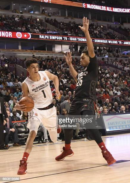 Michael Porter Jr #1 of the boys west team is defended by PJ Washington Jr #25 of the boys east team during the 2017 McDonalds's All American Game on...