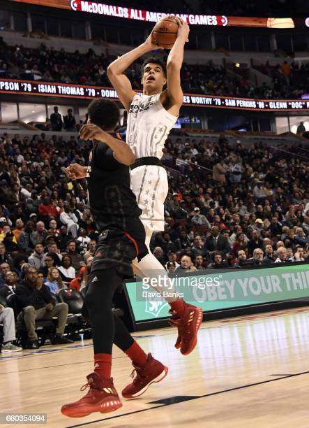 Michael Porter Jr #1 of the boys west team shoots over PJ Washington Jr #25 of the boys east team during the 2017 McDonalds's All American Game on...