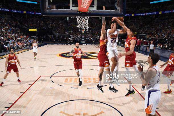 Michael Porter Jr. #1 of the Denver Nuggets blocks a shot by Cameron Johnson of the Phoenix Suns during Round 2, Game 4 of the 2021 NBA Playoffs on...