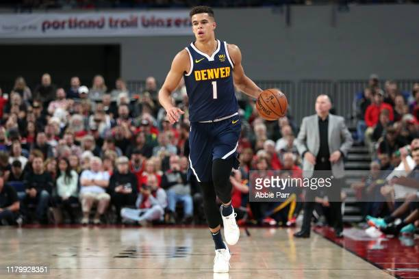 Michael Porter Jr #1 of the Denver Nuggets brings the ball up court in the fourth quarter against the Portland Trail Blazers during a preseason game...