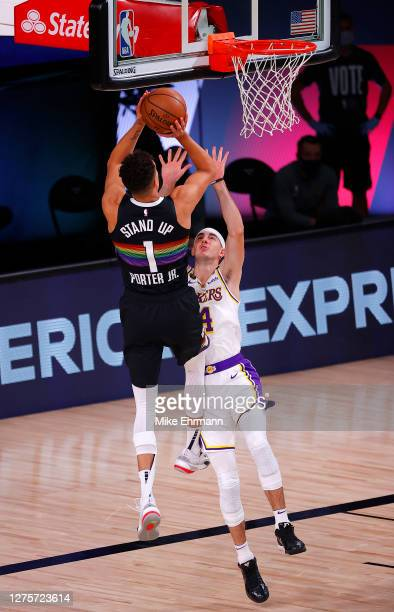 Michael Porter Jr #1 of the Denver Nuggets drives the ball against Alex Caruso of the Los Angeles Lakers during the first quarter in Game Three of...
