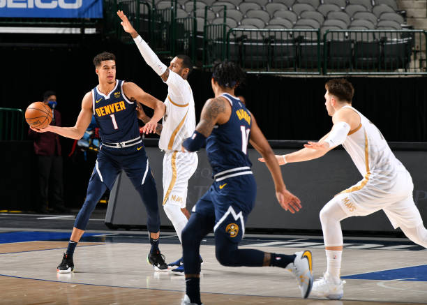 Michael Porter Jr. #1 of the Denver Nuggets passes the ball during the game against the Dallas Mavericks on January 25, 2021 at the American Airlines...