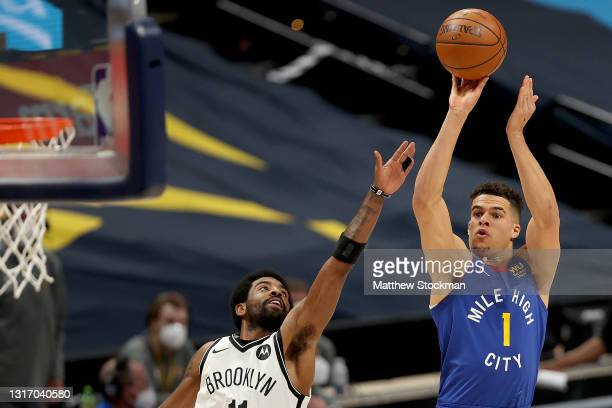 Michael Porter Jr. #1 of the Denver Nuggets puts up a shot over Kyrie Irving of the Brooklyn Nets in the first quarter at Ball Arena on May 08, 2021...
