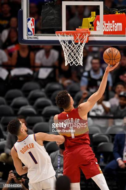 Michael Porter Jr. #1 of the Denver Nuggets scores on a layup past Devin Booker of the Phoenix Suns in Game Four of the Western Conference...