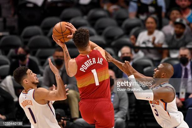 Michael Porter Jr. #1 of the Denver Nuggets scores on a layup past Devin Booker and Chris Paul of the Phoenix Suns in Game Four of the Western...