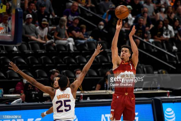 Michael Porter Jr. #1 of the Denver Nuggets shoots over Mikal Bridges of the Phoenix Suns in Game Four of the Western Conference second-round playoff...