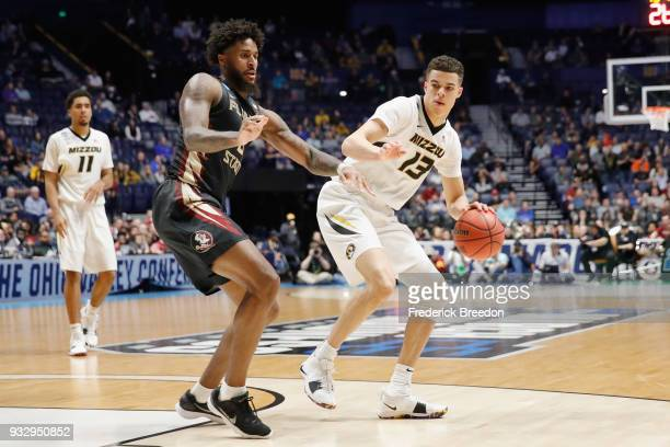 Michael Porter Jr #13 of the Missouri Tigers drives in to the lane against Christ Koumadje of the Florida State Seminoles during the game in the...