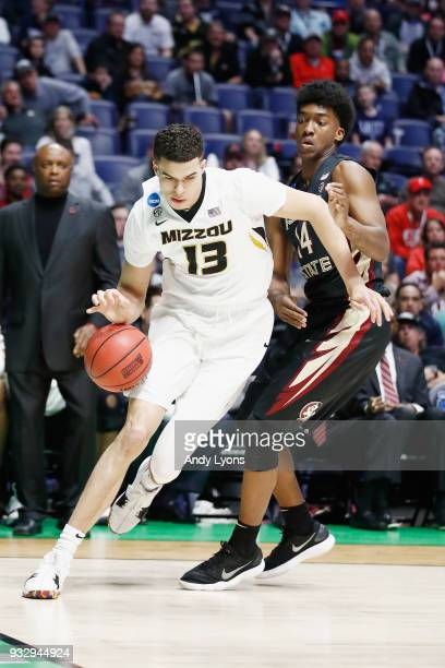 Michael Porter Jr #13 of the Missouri Tigers drives to the basket against Terance Mann of the Florida State Seminoles during the game in the first...