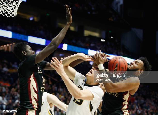 Michael Porter Jr #13 of the Missouri Tigers fights for a rebound with Christ Koumadje and PJ Savoy of the Florida State Seminoles during the game in...