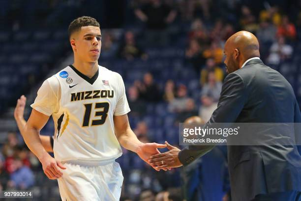 Michael Porter Jr #13 of the Missouri Tigers high fives head coach Cuonzo Martin as he comes off the court during a game against the Florida State...