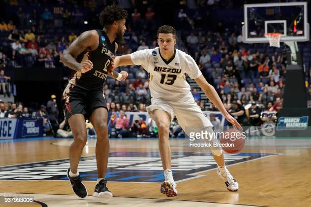 Michael Porter Jr #13 of the Missouri Tigers plays against Phil Cover of the Florida State Seminoles during the first round of the 2018 NCAA Men's...