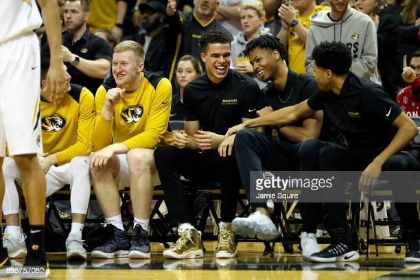 Michael Porter Jr #13 of the Missouri Tigers reacts from the bench during the game against the Stephen F Austin Lumberjacks at Mizzou Arena on...