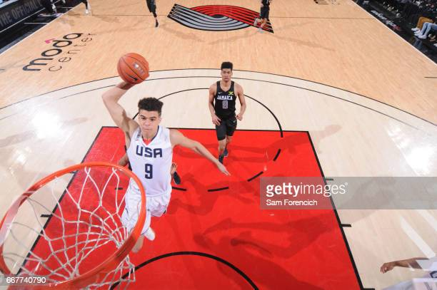 Michael Porter Jr #9 of the USA Junior Select Team dunks against the World Select Team during the game on April 7 2017 at the MODA Center Arena in...