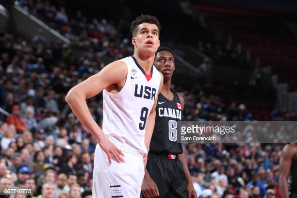 Michael Porter Jr #9 of the USA Junior Select Team looks on against RJ Barrett of the World Select Team during the game on April 7 2017 at the MODA...