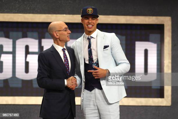Michael Porter Jr poses with NBA Commissioner Adam Silver after being drafted 14th overall by the Denver Nuggets during the 2018 NBA Draft at the...