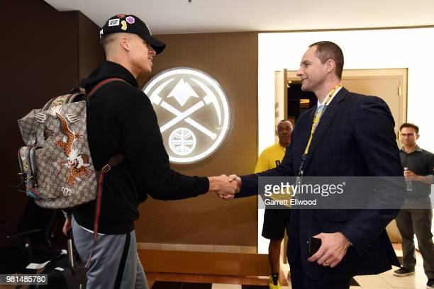 Michael Porter Jr shakes hands with general manager Arturas Karnisovas of the Denver Nuggets during a press conference on June 22 2018 at the Pepsi...
