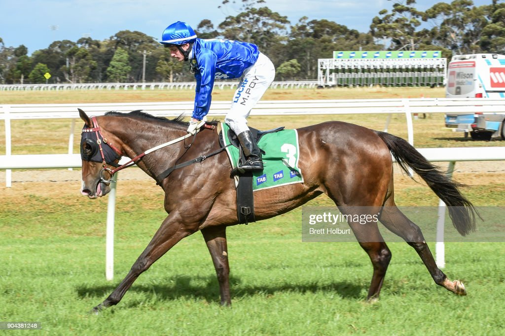 Michael Poy returns to the mounting yard on Bellaria (NZ) after winning the Werribee FC join as a Member F&M BM64 Handicap at Werribee Racecourse on January 13, 2018 in Werribee, Australia.