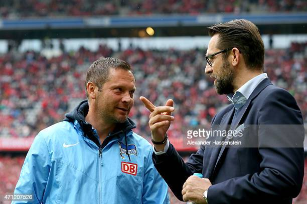 Michael Preetz CEO of Berlin talks to his head coach Pal Dardai prior to the Bundesliga match between FC Bayern Muenchen and Hertha BSC Berlin at...
