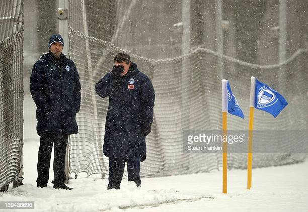 Michael Preetz, manager of Berlin talks to Otto Rehhagel, new head coach of Hertha BSC Berlin as he takes charge of his first training session with...