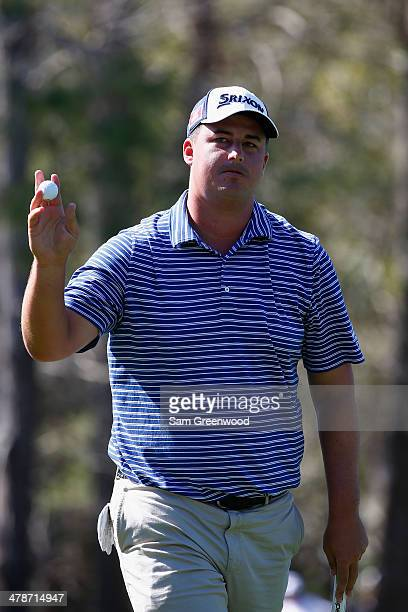 Michael Putnam acknowledges the gallery on the 15th green during the second round of the Valspar Championship at Innisbrook Resort and Golf Club on...