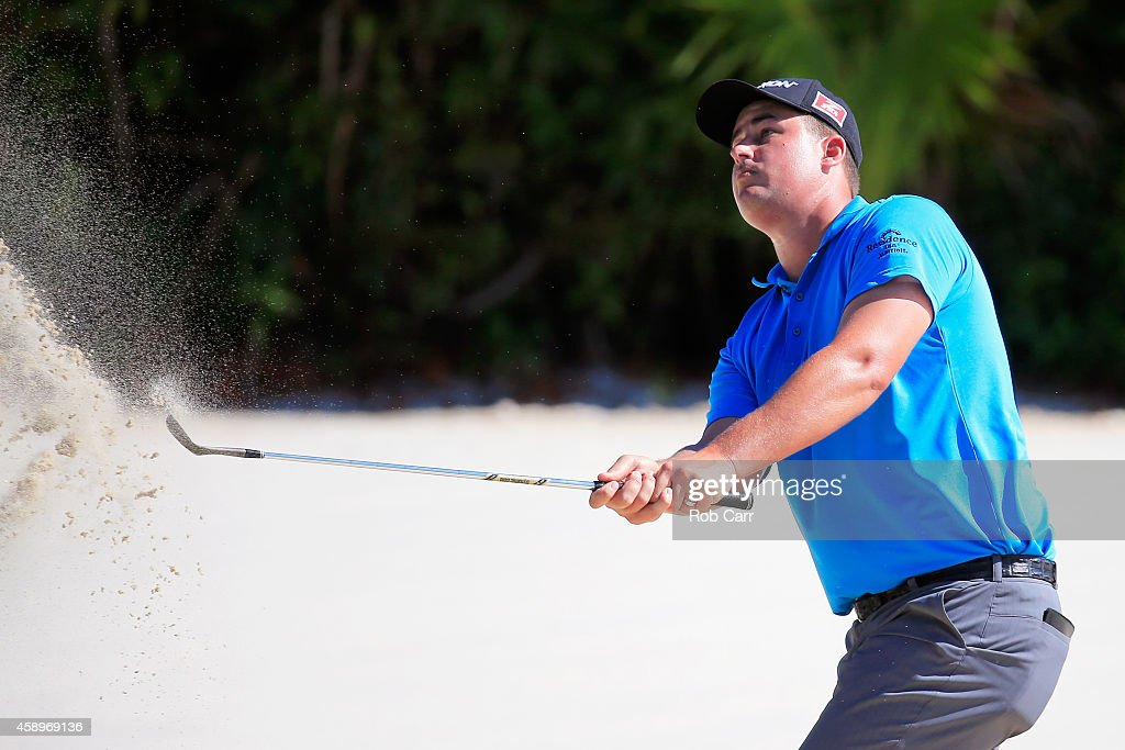 Michael Putnam of the United States hits a shot out of a bunker on the 16th hole during the second round of the OHL Classic at Mayakoba on November 14, 2014 in Playa del Carmen, Mexico.