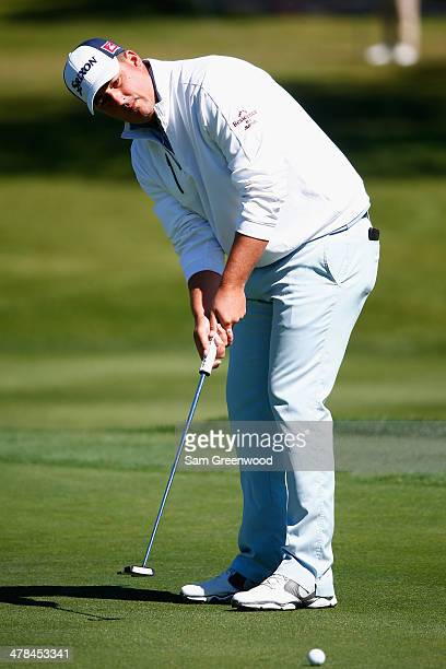 Michael Putnam putts on the 8th green during the first round of the Valspar Championship at Innisbrook Resort and Golf Club on March 13 2014 in Palm...