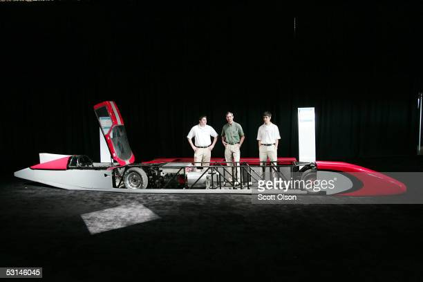 Michael Quade John Neal and Kevin Poziani display the Buckeye Bullet a 321 mileperhour electric car built by Ohio State University engineering...