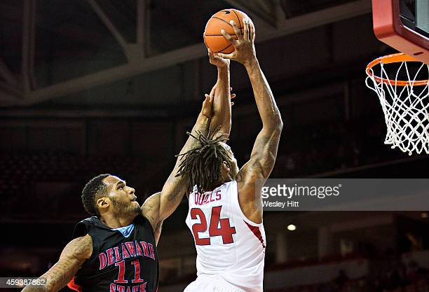 Michael Qualls of the Arkansas Razorbacks goes up for a dunk in the first half over DeAndre Haywood of the Delaware State Hornets at Bud Walton Arena...