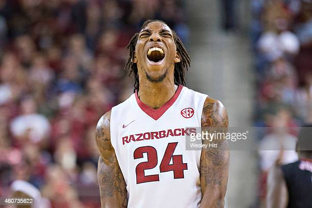 Michael Qualls of the Arkansas Razorbacks yells after a big play against the Southeast Missouri State Redhawks at Verizon Arena on December 20, 2014...