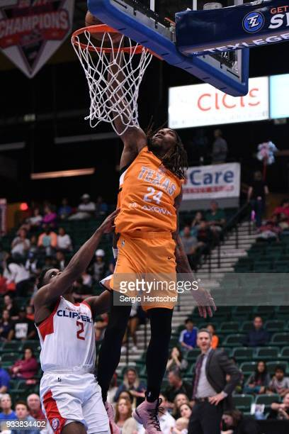 Michael Qualls of the Texas Legends dunks against Ike Iroegbu of the Agua Caliente Clippers on March 18 2018 at the Dr Pepper Arena in Frisco Texas...