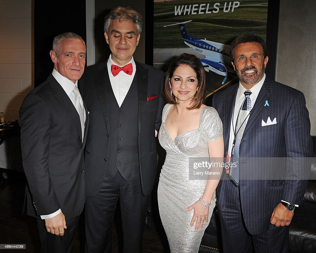 Michael R. Yormark - President and CEO of Sunrise Sports and Entertainment, Andrea Bocelli, Gloria Estefan and Frank G. Russo pose backstage during Bocelli's Valentines Day concert at BB&T Center on February 14, 2014 in Sunrise, Florida.